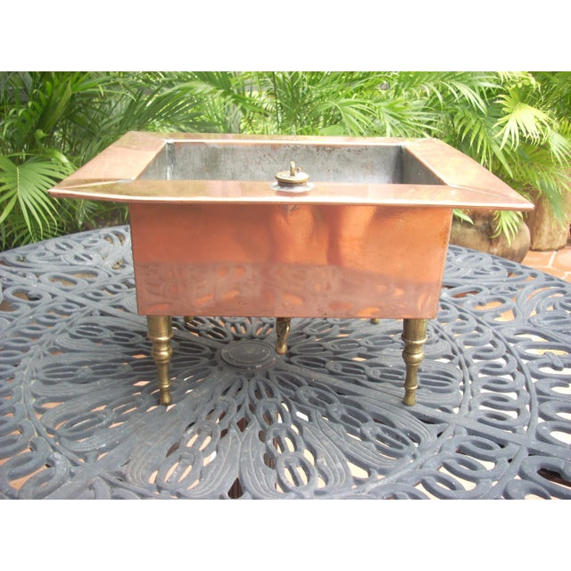 This is a 19th century copper steam bath on brass legs with brass valves which was used to heat volatile or flammable...