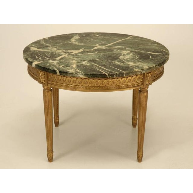 Unusual Louis XVI style gilded coffee table with a marble top in nice original unrestored condition.
