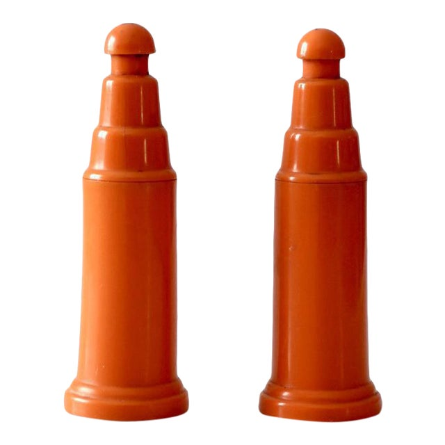 Vintage Push Top Orange Plastic Salt and Pepper Shakers For Sale