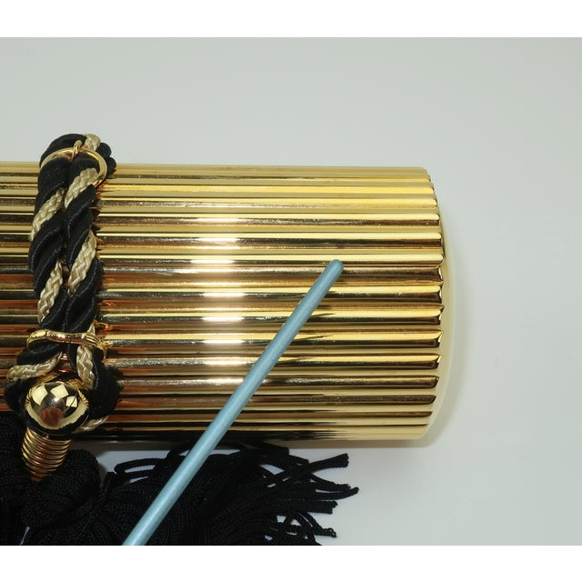 Walborg Gold Metal Cylinder Handbag With Black Tassel Closure For Sale - Image 10 of 13