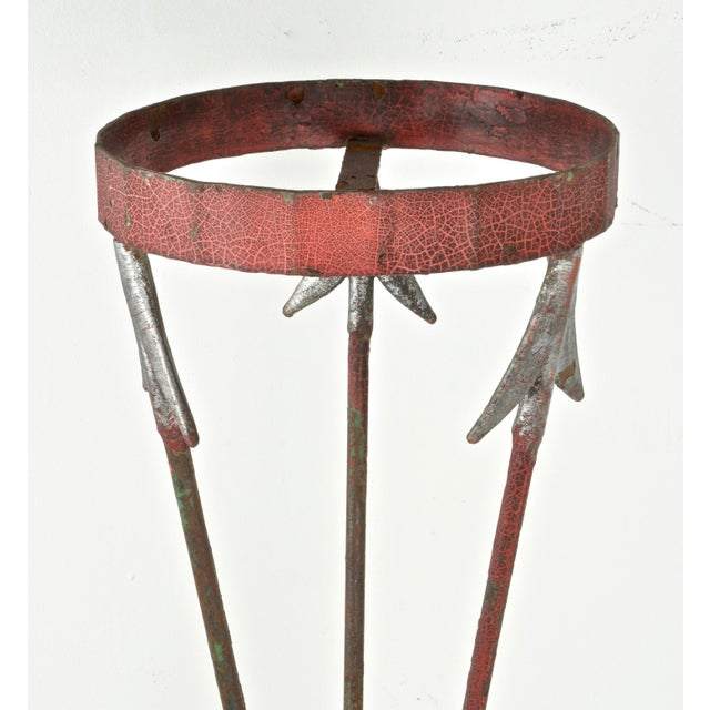 Great patina on this cast iron plant stand --aged red and silver paint along with the neoclassical motif of crossed...