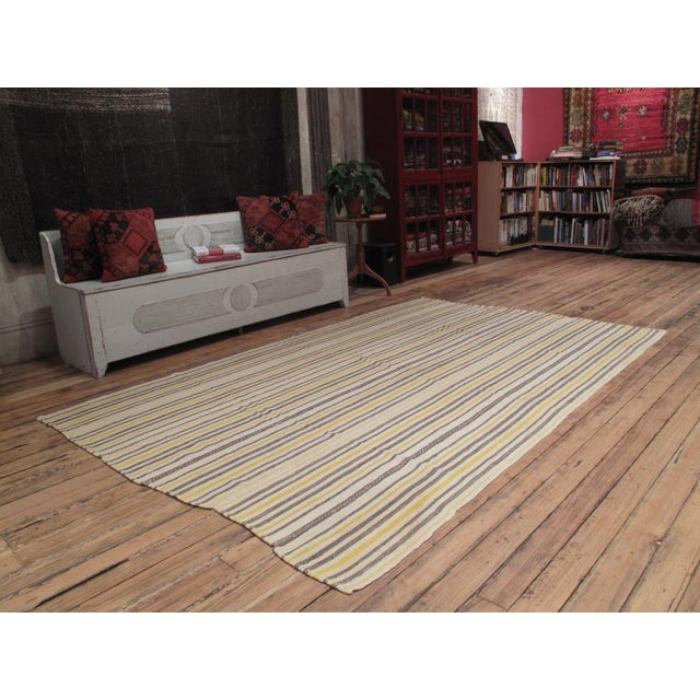 A finely woven tribal cover, made of narrow panels. Can be used as a floor cover, curtain or for upholstery. Size can be...
