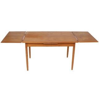 Extending Teak Dining Table by a.b.j.