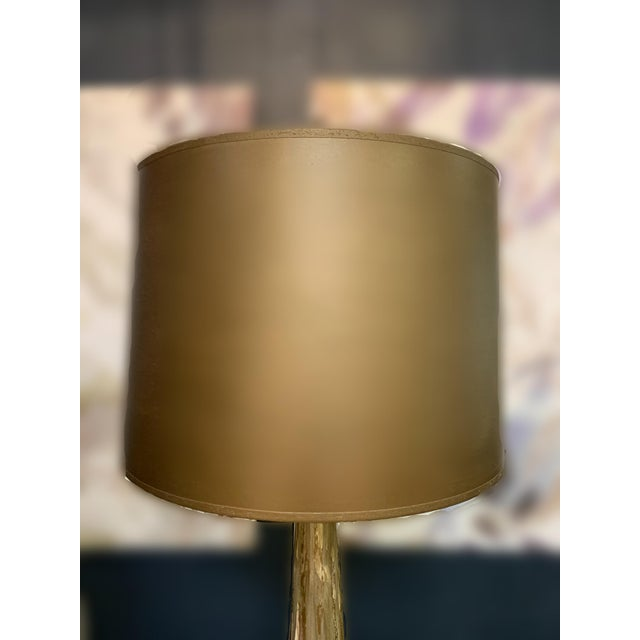 This elegant table lamp elevates any space. The beautiful details of the ivory ceramic glaze base with the gorgeous shade...
