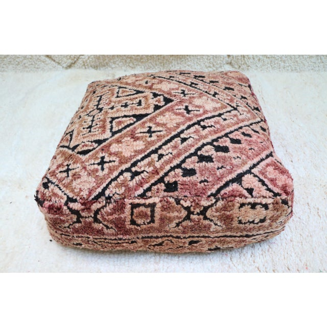 Unique Vintage Moroccan Floor Pillow hand-woven by Artist Berber craftswomen from vintage Moroccan boujaad rugs that has...