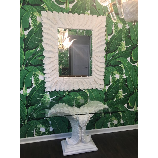 Console table sculpted in the form of large palm leaves with matching mirror. Based on the style of Serge Roche or Dorothy...