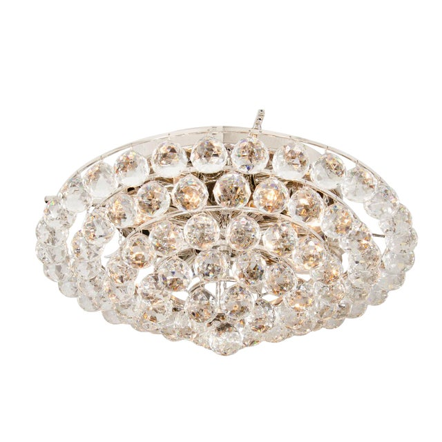Flush mount ceiling fixture composed of multiple tiers of facet cut crystal ball elements. 12 candelabra sockets. From...