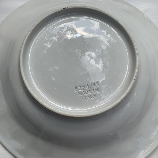 Great salad bowl which could also double as a serving bowl trimmed in green leaves with salmon-colored accents.