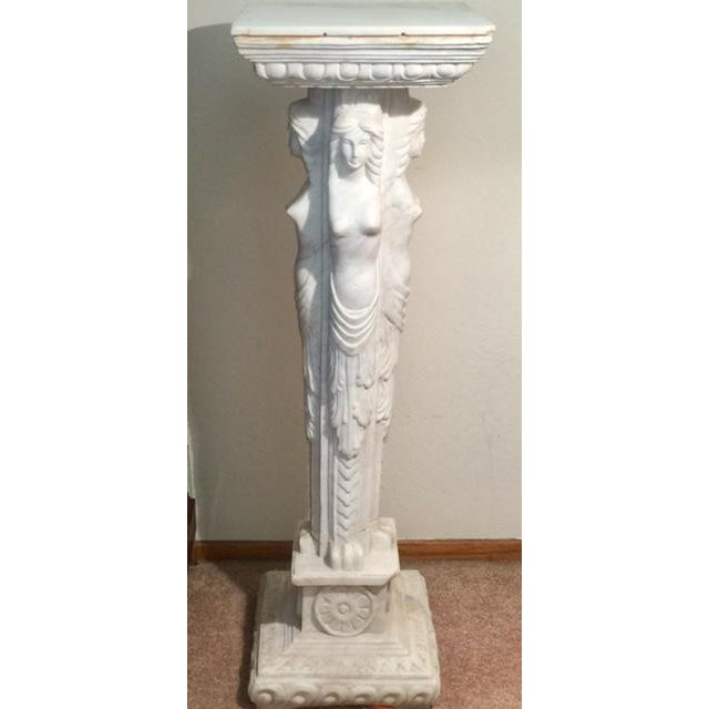 Beautiful marble pedestal with draped maidens. It has a small chip on top, small chip on small base, bottom base is...