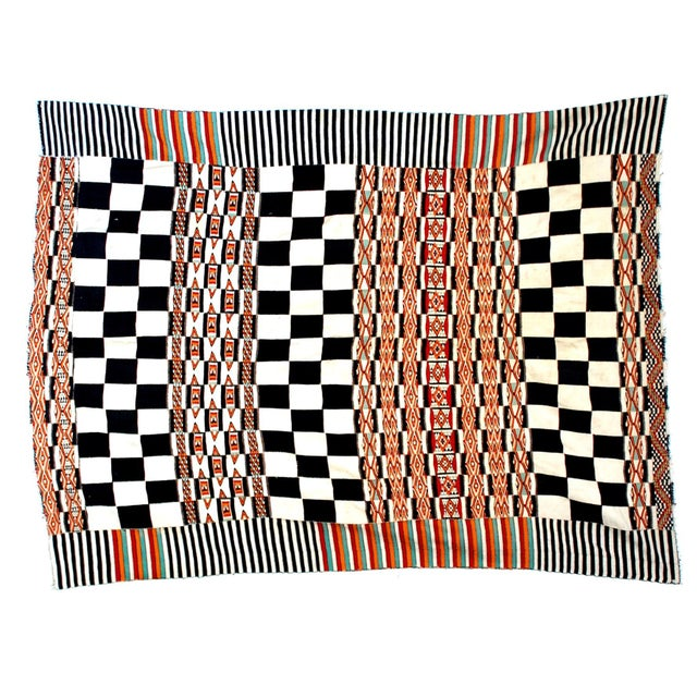 Nomadic wedding blanket woven from multiple cotton strips made by the Fulani people of North Africa.