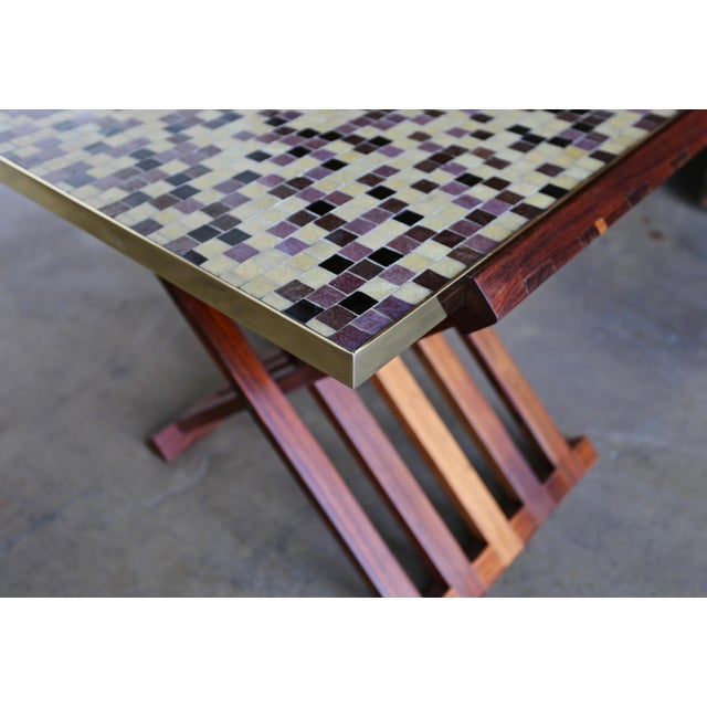 Edward Wormley X-base rosewood and Murano tile-top table. Manufactured by Dunbar, circa 1955. Highly figured grain to the...