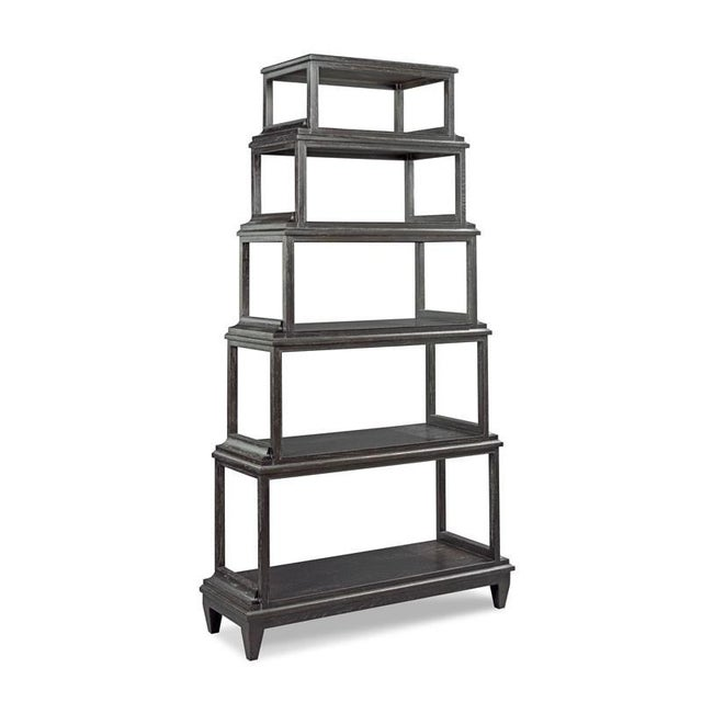Six tiered shelves are stacked one on top of the other and raised by a base with tapered legs. Crafted from oak solids and...
