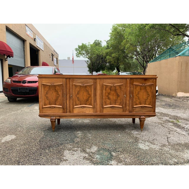 French Art Deco exotic solid walnut sideboard or buffet, circa 1940s. This piece displays very high levels of...