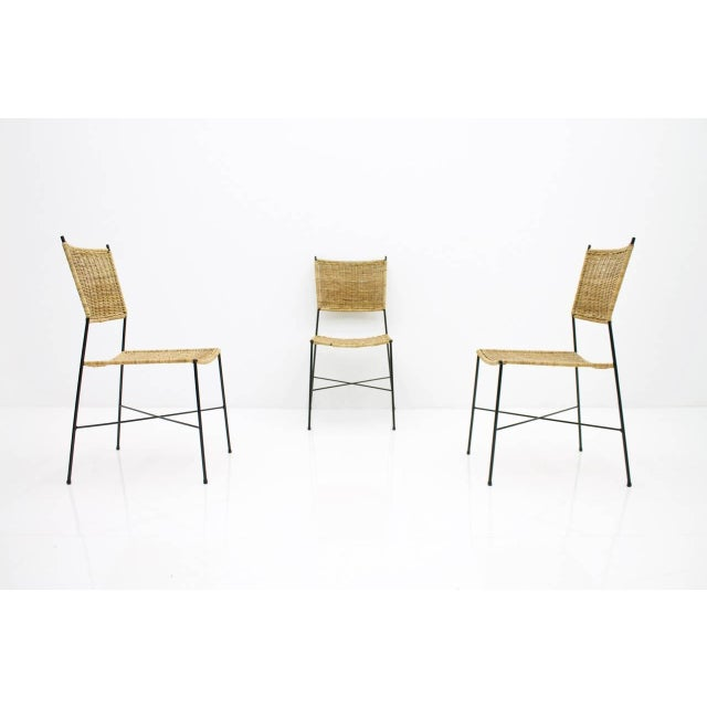 Set of four dining room chairs in wicker and metal, Germany, 1960s. Good condition with small signs of usage.