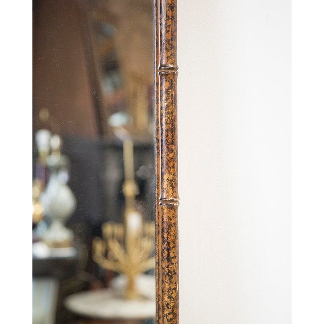 A large scale 1970's mirror with a rich, tortoiseshell finish hand applied to a faux bamboo frame and Geometric Detail at...