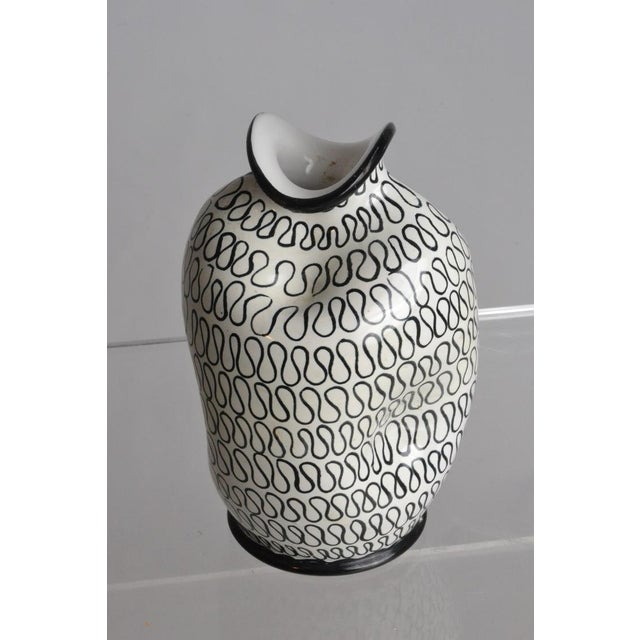 Italian pottery vase with pinch form. Its black and white design has a contemporary feel. Circa 1960s.