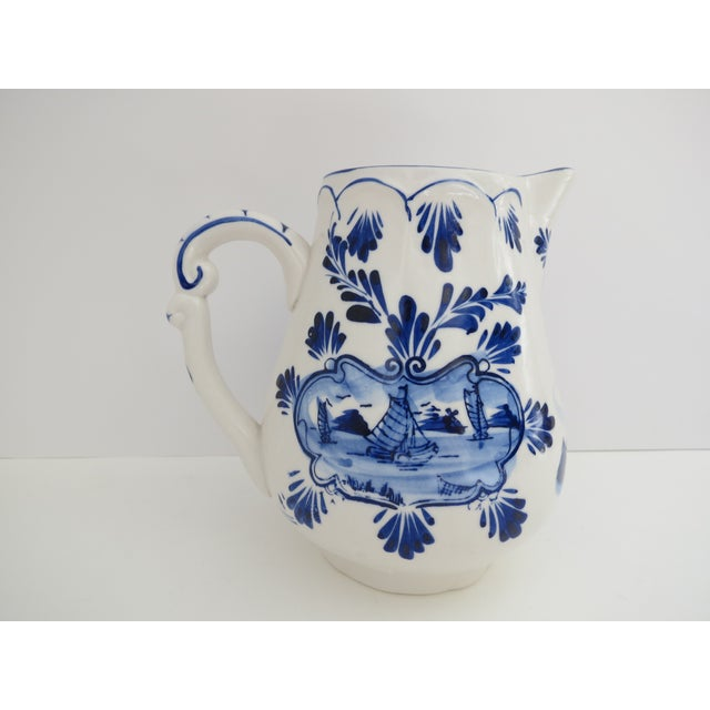 Cobalt blue and white hand painted Delft pitcher. Made in Holland.