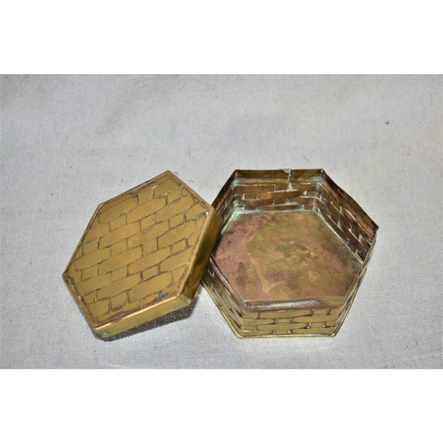 Fabulous vintage box. Made of brass in a basketweave pattern. In a hexagon shape. Perfect to use for jewelry or...