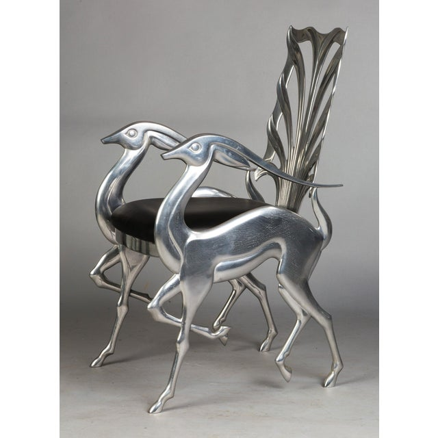 This is a contemporary and unique signed designer chair with Impala side panels and legs by artist and designer Ray Lewis,...