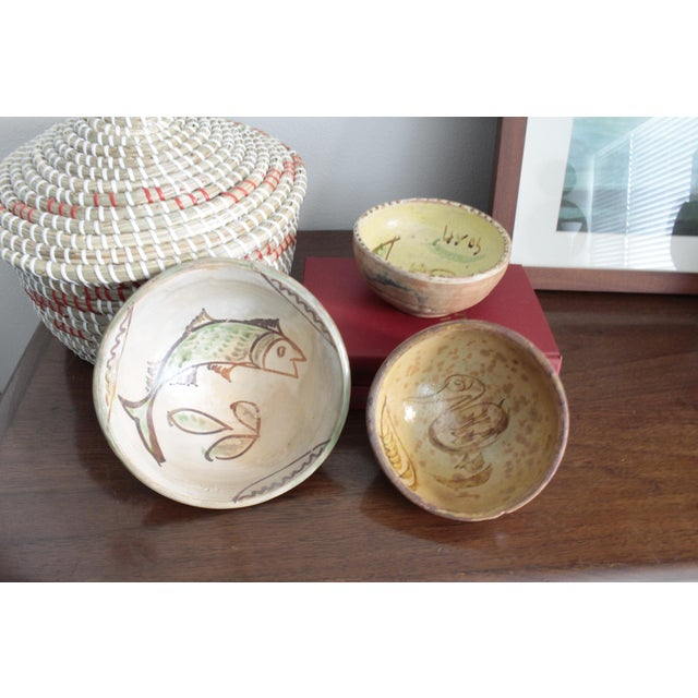 Hand made Tlaquepaque clay pottery bowls with hand painted designs in the Patamban traditional style. The larger bowl has...