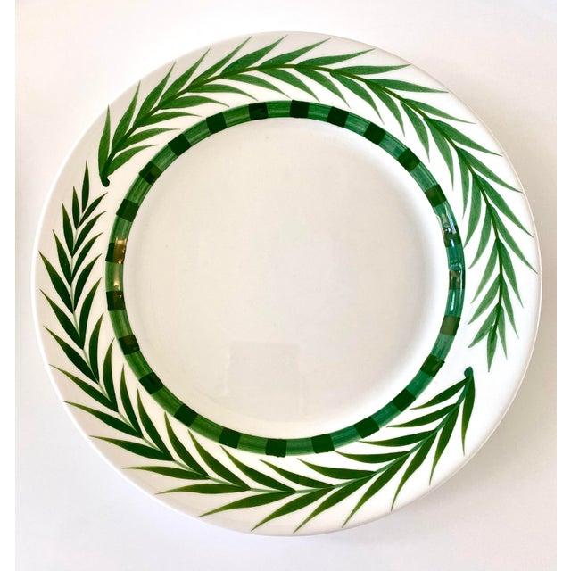 Set of 7 original ceramic plates by Este Ceramiche Vietri. An elegant white background with the verdant green hues of...