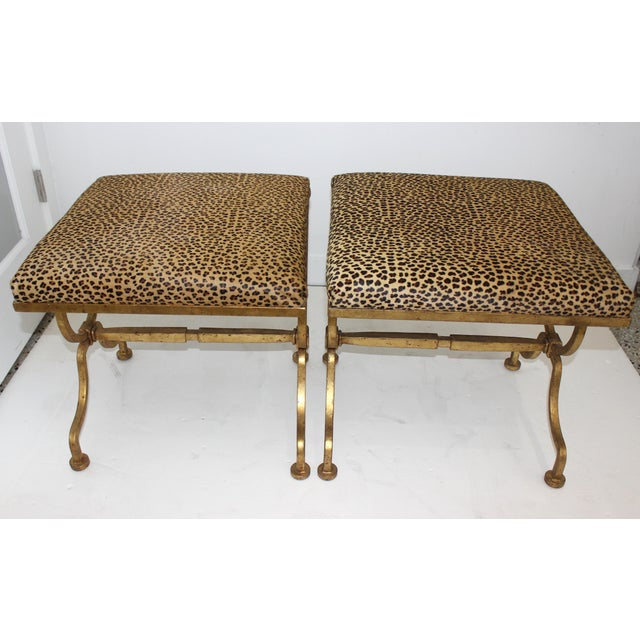 Stylish gilded Wrought iron with faux leopard hide upholstery stools from a Palm Beach estate., inspired by the Arbus...