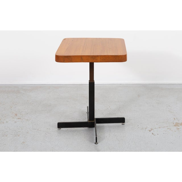 """square table designed by Charlotte Perriand for Les Arcs 2000 France, c 1968 enameled steel + pine 29 ⅞"""" h x 23 ½"""" w x 22..."""