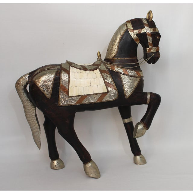 Fabulous wood carving of a horse wearing a metal decorated bridle and bone veneered saddle. One of a kind. In great...