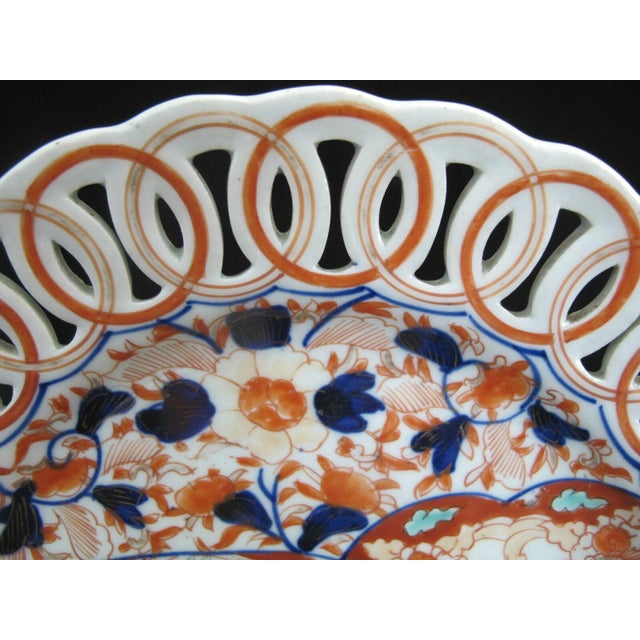 Beautiful Japanese, 19th Century Imari dish with pierced, scalloped rim. Hand painted fan and flower design in blue, red,...
