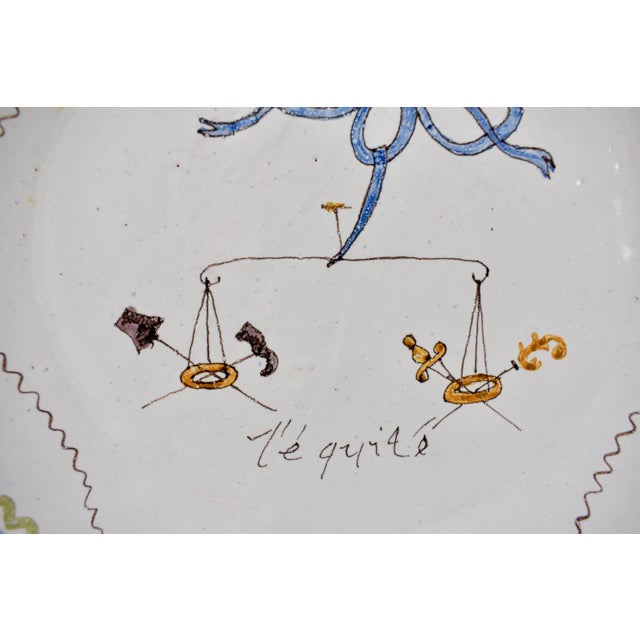 A French Revolution tin-glazed earthenware dish, made in Nevers, circa 1790, called l'équité or the Justice. Showing a...