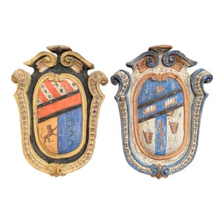 Pair of Early 20th Century French Carved Painted Wall Hanging Shields With Crest For Sale