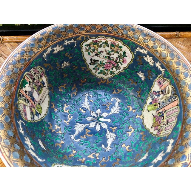 Traditional rose medallion bowl in a not so traditional blue! Features social scenes as well as medallions of nature...