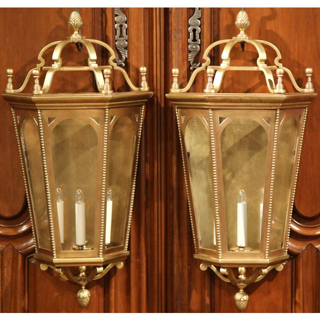 This elegant pair of traditional wall lights were created in France, circa 1900. Each of the Classic, three-light sconces...