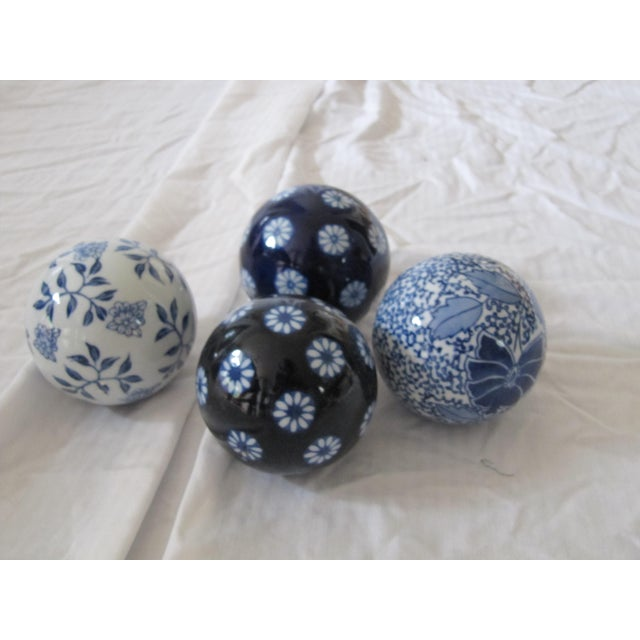 Blue & White chinoiserie balls with flower details. Set of 4.