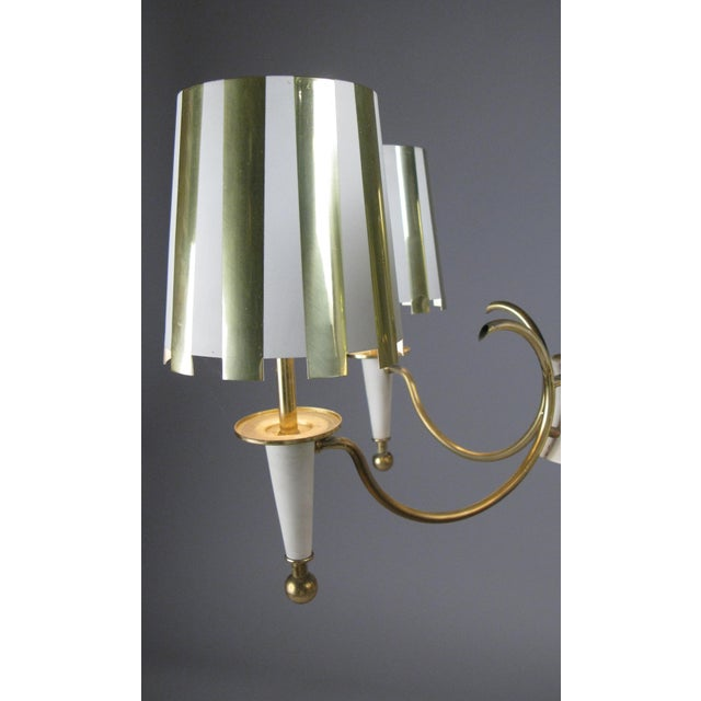 A very charming vintage 1960s five-light chandelier, with a brass frame, and five shades in polished brass and white...