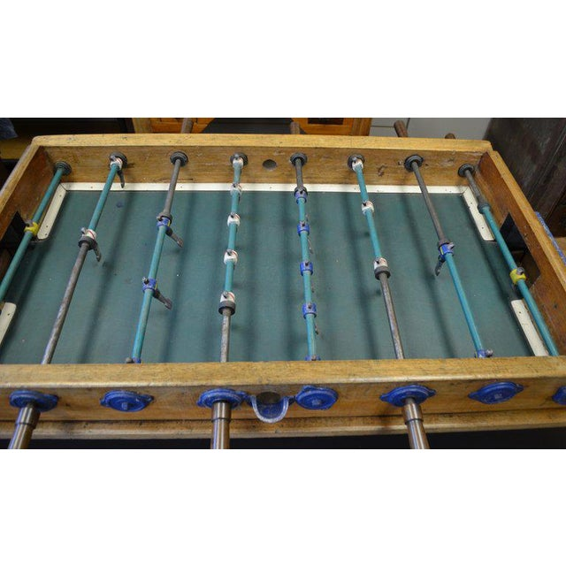 Mid-century foosball table from Italy on hand-made wooden stand. Includes rare painted steel-bodied players, leather...