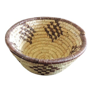 Small Tribal Woven Basket in Natural and Brow For Sale