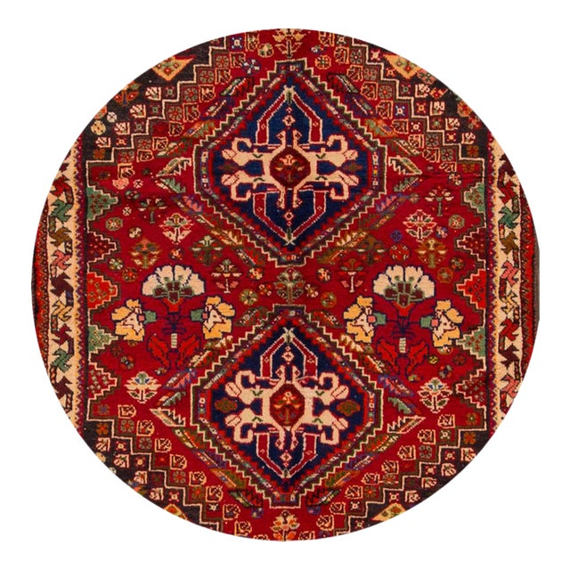 Vintage hand-knotted Persian Shiraz rug with a medallion motif. This piece has magnificent detailing and great colors. It...