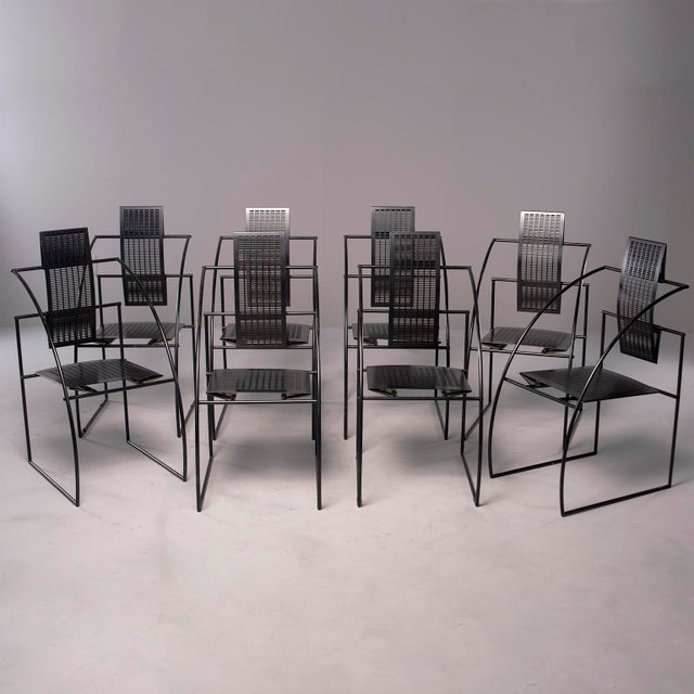 Offered are a set of eight Quinta chairs designed by Mario Botta for Alias of Italy. These black metal chairs have a...