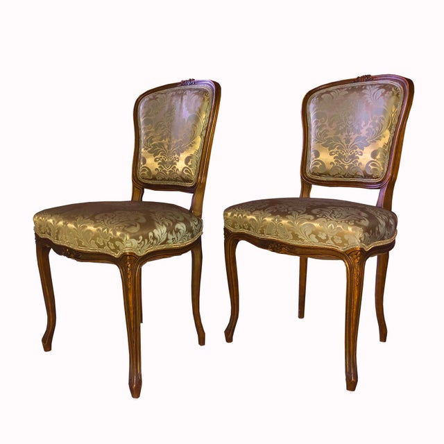 Classic Louis XV Style Wood Chairs with lacquered finish and baroque patterned fabric. From the Estate of Rudolph...