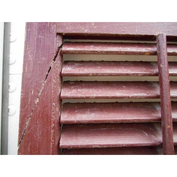 What is better that old red paint on an old pair of wood shutters? How about some old hardware and latches to go with it....