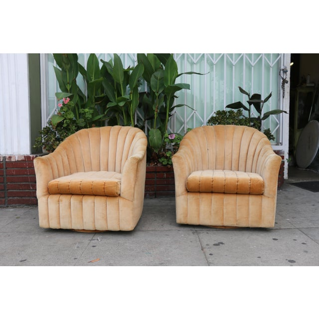Velvet pair of Hollywood Regency Style Pair of Chairs in Vintage Condition Has minor stains on fabric. Swivel base works...