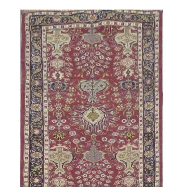 This beautiful rug is hand made, made in Iran. It features a pattern in a vibrant combination of red, navy blue, grey,...