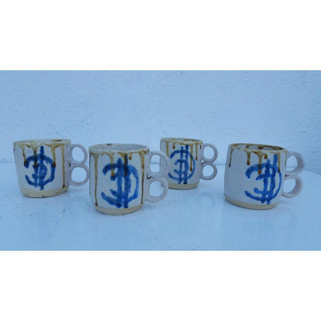 Vintage artisan, hand thrown, double handle, white and brown drip glaze design coffee cups. All pieces are marked on the...