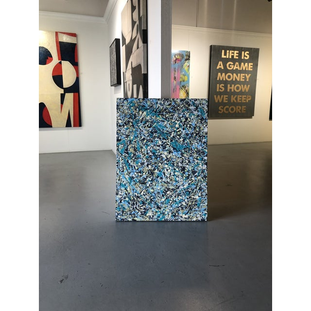 Original abstract painting in the style of Jackson Pollack by Florida artist Manuel Roberto Originally from Cuba, living...