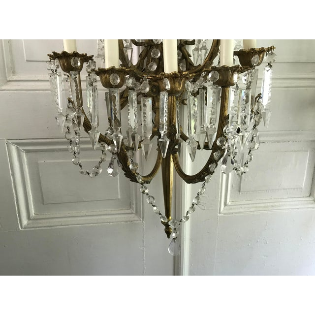 A Pair of Antique French Crystal Bronze 18 Light Sconce Pair - Image 5 of 6