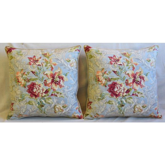 Pair of custom-tailored pillows in French linen fabric with a traditional floral design. Cream cotton-velvet fabric backs....