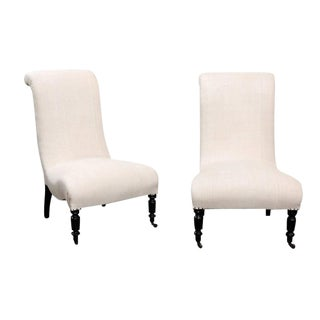 Pair of English Upholstered and Ebonized Wood Slipper Chairs, circa 1900