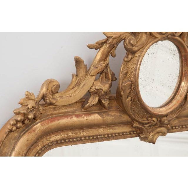 French 19th Century Ornately Carved Giltwood Over-Mantle Mirror For Sale - Image 9 of 13