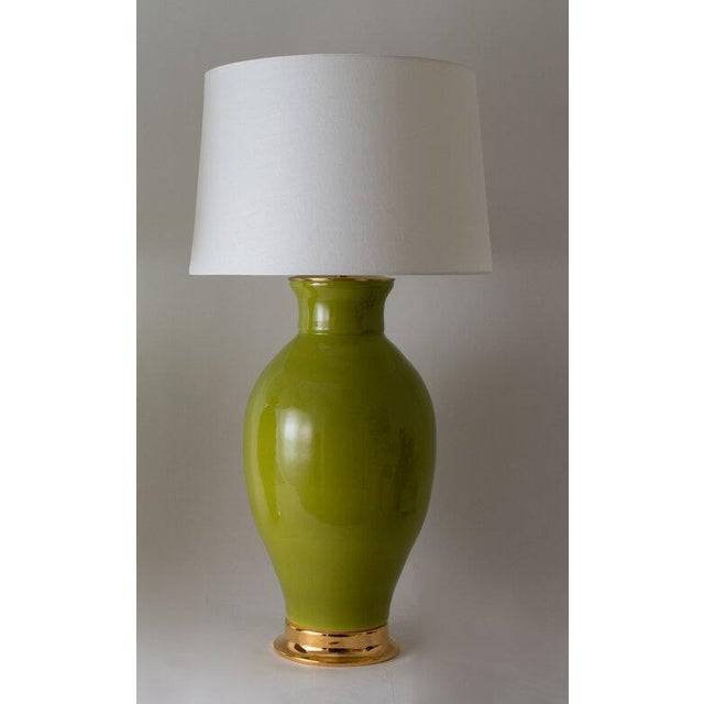The MATAGORDA lamp is shown in our Glossy Olive glaze. Handmade and signed by Paul Schneider. Lead time three weeks. LAMP...